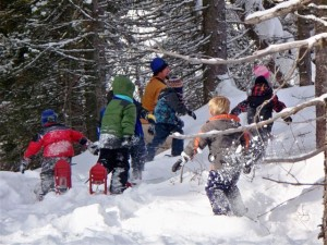 Kids play game in the snow.